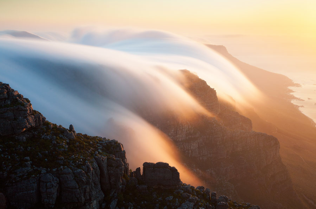 See the clouds tumble off Table Mountain, Cape Town. Photo credit: Hougaard Malan on 500px.com